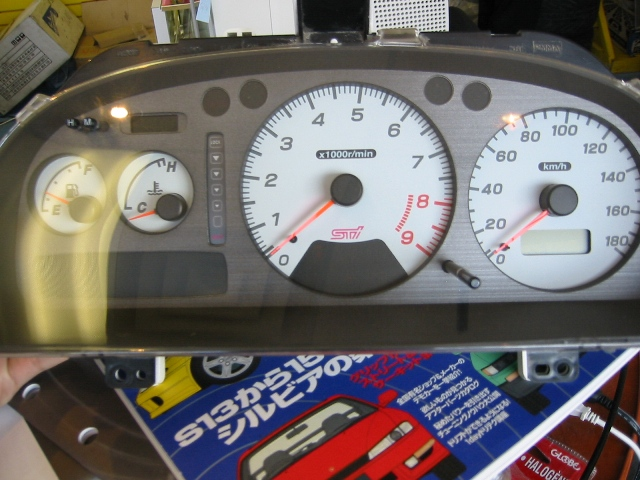 GU10003 - JDM GC8 Impreza Version 4 STI gauge cluster with DCCD with center tach white face, fits 98 Imprezas ONLY.